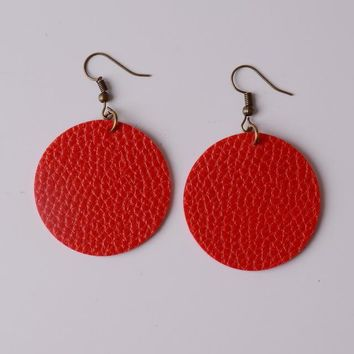 Simple round leather drop earrings with antique gold tone hooks