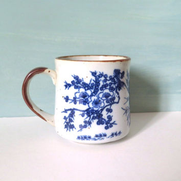 Blue and White Stoneware Coffee Mug with Brown Handle