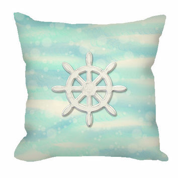 Nautical Ship's Wheel Throw Pillow on sea and sand with bubbles