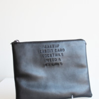 NECESSITIES ZIP CLUTCH