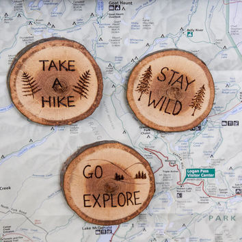 Rustic Wood Burned outdoors inspiration magnets. Stay Wild, Go Explore, or Take a Hike with ferns, trees, or mountains on a slice of wood