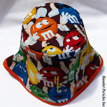 M&Ms Candy Bucket Hat | MandM Hat | Food Hat | Chocolate Candy Hat | Multicolored Unisex Small Hat by Hamlet Pericles | HP42716