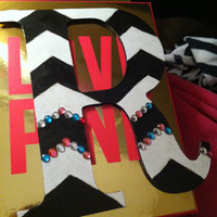 Painted chevron letter