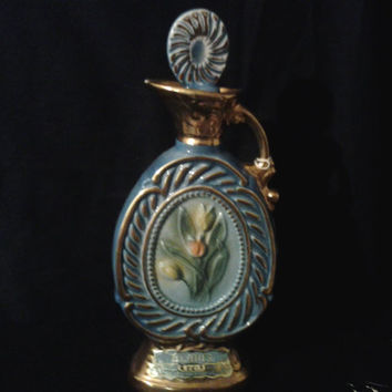Clearance priced, 1973 collectable Jim Beam Whiskey decanter. porcelain china with tulip design, blue, pastels, and gold leaf accent.