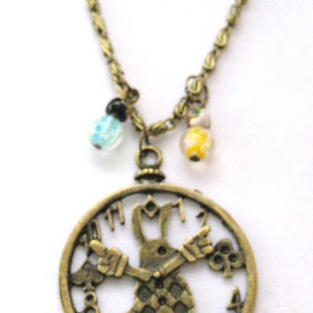 Alice in wonderland  Necklace  white rabbit with glow in the dark glass beads  on chain