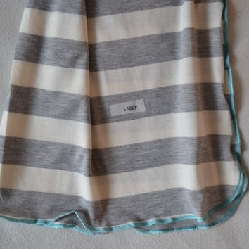 Baby boy swaddler. Soft and stretchy striped fabric.  Colors- gray and cream with blue edging.   Made by lippy brand.