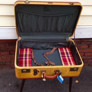 upcycled brass detailed vintage suitcase end side table with mid century wood legs and PanAm luggage tag