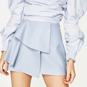 LEATHER-EFFECT MINI SKIRT WITH FRILLSDETAILS