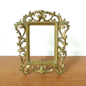 Heavy baroque gold metal frame with 3 3/4 x 5 1/2 inch opening, easel frame