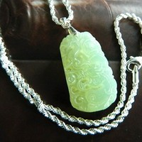 Carved light green jade pendant on 925 chain