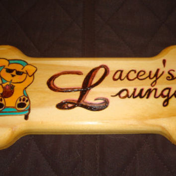 """Dog Bone Signboard 16.00"""" x 6.00"""" x 0.69"""" Made from pine, wood burned, colored with oil pencil and finished with tung oi"""
