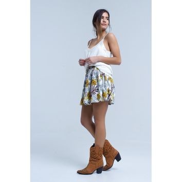 Yellow mini skorts with floral print