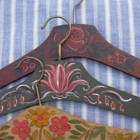 Vintage wooden clothes hangers, hand painted.