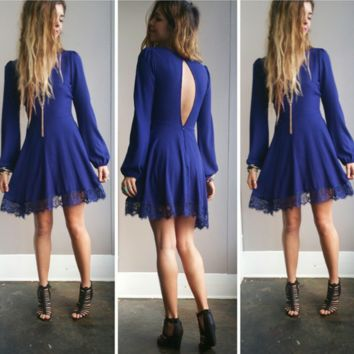 An Open Back Lace Dress in Navy