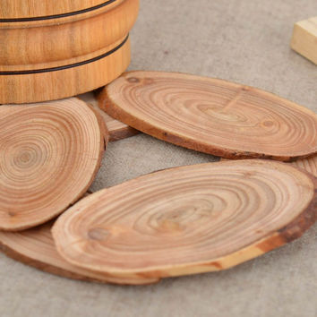 Handmade small convenient eco friendly natural wooden trivet of round shape