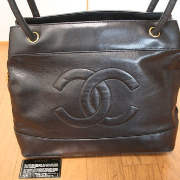 Vintage CHANEL black classic tote bag in nappa leather with gold tone circle CC charm and large CC stitch mark.  Perfect daily purse