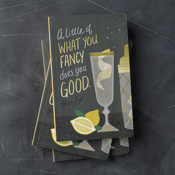 A Little Of What You Fancy Does You Good Journal in Gold on Black