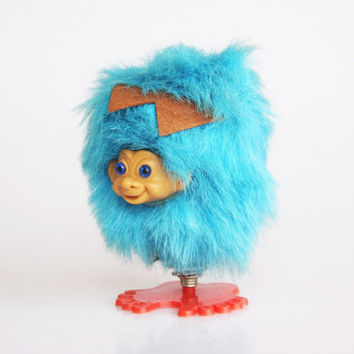 Retro blue hairy troll on a spring, vintage blue jumping animal toy, 1970 toy troll doll, spooky cute vintage toy, blue Dam troll toy