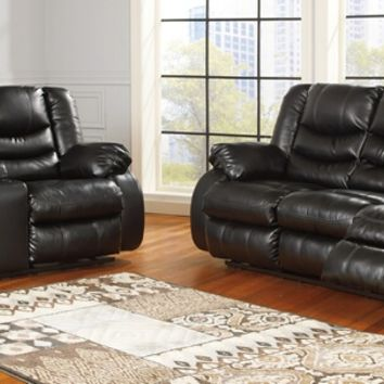 Ashley Furniture 95202-88-94 2 pc linebacker collection black colored durablend leather upholstered sofa and love seat set with recliners on the ends