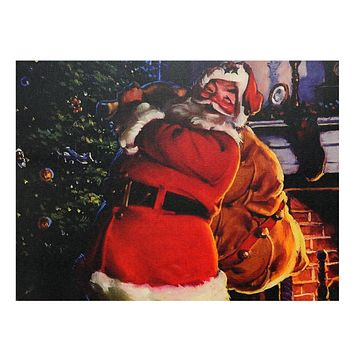 """LED Lighted Jolly Santa Claus with Bag of Gifts Christmas Canvas Wall Art 11.75"""" x 15.75"""""""
