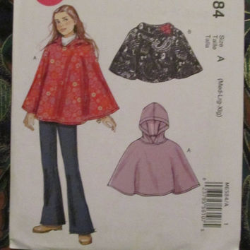SALE Uncut McCall's Sewing Pattern, 6584! Medium/Large/XL Girls Ponchos/Rain Poncho/Hooded Poncho/Collared Poncho/Spring/Fall/Winter