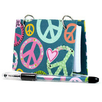 Index card binder with multicolored peace symbols on teal blue 381