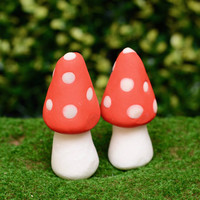 Glow in the dark red and white large fairy garden mushrooms