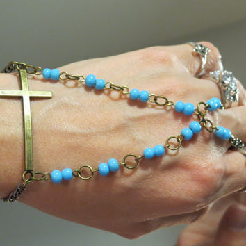 "Beaded Cross ""Slave Bracelet"" Ring. Religious Christian, Catholic Bracelet with baby blue beads. Adjustable. Fits wrists 6 to 8 inches."