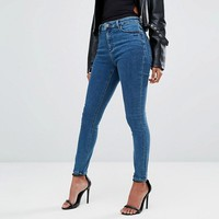 ASOS PETITE Ridley Ankle Grazer Jeans in Lanie Wash at asos.com