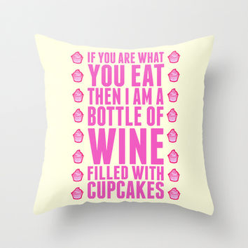 A Bottle of WIne Filled With Cupcakes Throw Pillow by LookHUMAN