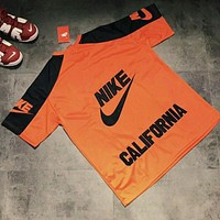 NIKE Fashion new letter number 10 print women and men sports loose leisure short sleeve t-shirt top Orange