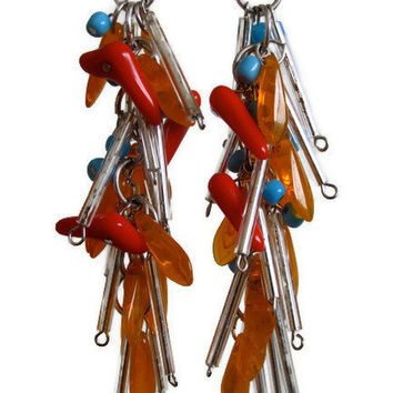 Chandelier earrings beaded funky color combination in orange, light blue and red, glimmery extra long white beads.