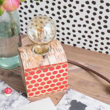 Small birch wood lamp with red polka dot decor on side
