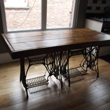 RUSTIC DINING TABLE  with vintage singer sewing machine treadles. Handmade from reclaimed timber finished in dark oak briwax