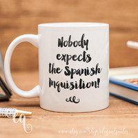 "Monty Python mug with quote ""Nobody expects the Spanish Inquisition!"" from Monty Python Flying Circus"