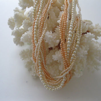 11 Strand Salmon and Cream Bead Necklace Vintage