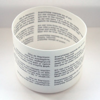 Fine bone china vessel with Greek song lyrics in both Greek and English