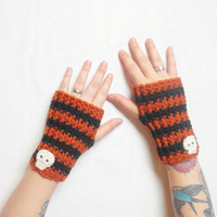Crochet Wrist Warmer Gloves in Pumpkin Orange and Black Stripes with Skulls, ready to ship.