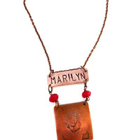 Marilyn Monroe etched copper pendant necklace. Red stone.
