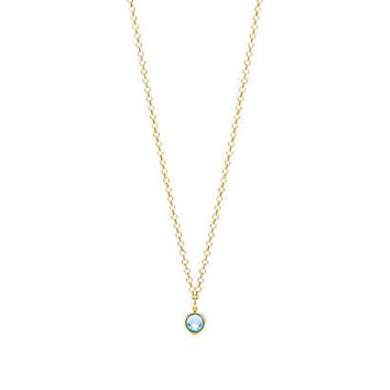 Tiffany & Co. - Paloma Picasso® blue topaz dot charm in 18k gold on a round link chain.