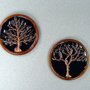 Decorative wall art featuring copper wire trees - set of two.