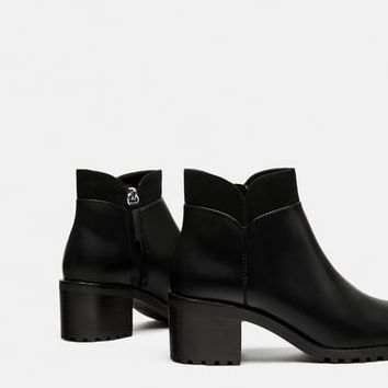 HIGH HEEL ANKLE BOOTS WITH TRACK SOLES DETAILS