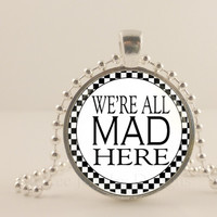 "Alice and Wonderland, were all mad here, black and white, 1"" glass and metal Pendant necklace Jewelry."