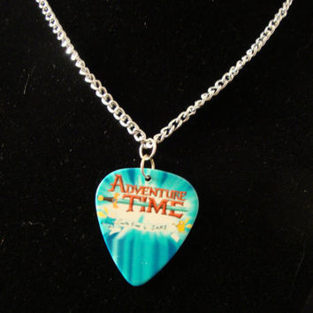 Custom made Adventure Time logo guitar pick on a silver chain necklace