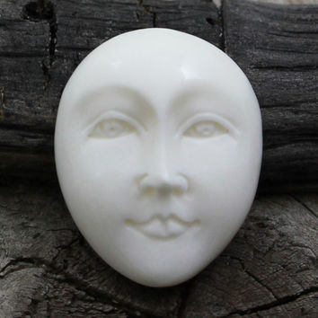 Oval Face Cabochon, Carving from Bone, Eyes Open