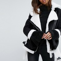 Story Of Lola Faux Shearling Jacket With Contrast Seams at asos.com