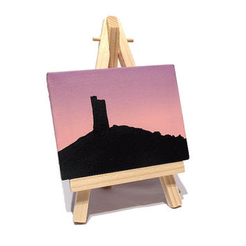 Castle Hill Mini Painting - small acrylic art of Huddersfield landmark, silhouette with a pink purple dawn sky. Miniature canvas with easel