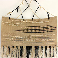 Bohemian handwoven wall hanging in natural white wool and hand dyed brownish wool