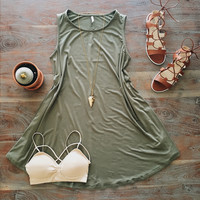 A Sleveless Swing Dress in Olive