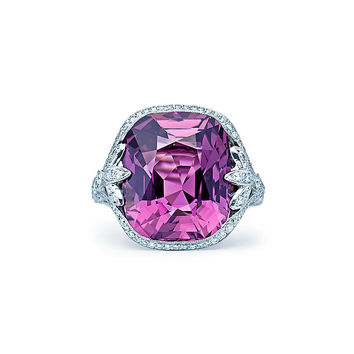 Tiffany & Co. - Cushion-cut purple sapphire ring in platinum with round brilliant diamonds.